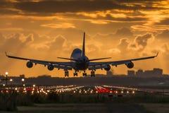 Huge Boeing is landing on the runway. Royalty Free Stock Image