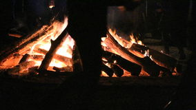 Huge bonfire and people dancing around it stock video footage