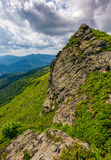 Huge boulder on the edge of a hill. Beautiful valley view from the top Stock Images