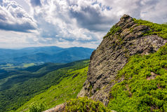 Huge boulder on the edge of a hill. Beautiful valley view from the top Royalty Free Stock Images