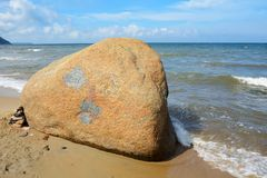 A huge boulder on the seashore. A huge boulder on the beach resort of Svetlogorsk, Kaliningrad region Stock Photo