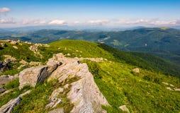 Huge boulders on the edge of hillside. Fine weather in summer mountain landscape Stock Image