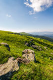 Huge boulders on the edge of hillside. Fine weather in summer mountain landscape Stock Images