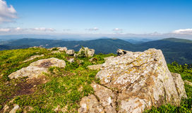 Huge boulders on the edge of hillside. Fine weather in summer mountain landscape Stock Photography