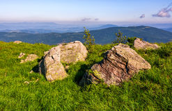 Huge boulders on the edge of hillside. Fine weather in summer mountain landscape Stock Photos
