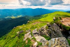 Huge boulders on the edge of hillside. Fine weather in summer mountain landscape royalty free stock image
