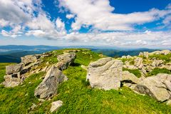 Huge boulders on the edge of hillside. Fine weather in summer mountain landscape stock image