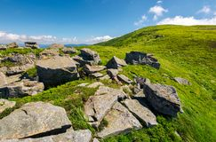Huge boulders on the edge of hillside. Fine weather in summer mountain landscape stock photo