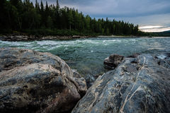 Huge boulders. In line with a mountain stream Stock Photography