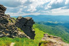 Huge boulders in valley on top of mountain ridge. Mountain summer landscape. meadow with huge boulders among the grass on top of the hillside near the peak of stock photography