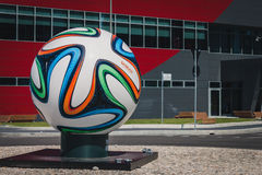 Huge Brazuca official match ball in the middle of a roundabout in Milan, Italy Royalty Free Stock Images