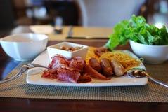 Huge breakfast. Rich nutritional breakfast buffet:lettuce, noodle, hot dog, rib Royalty Free Stock Image