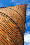 Huge brick chimney under blue sky Stock Photo