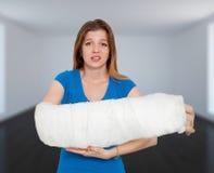 Huge Broken Hand. Woman With Huge Broken Hand In Bandage royalty free stock images