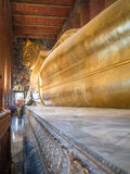 Huge Buddha made of gold is on a pedestal Royalty Free Stock Image