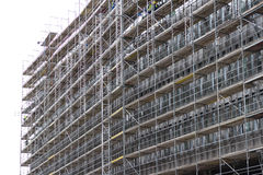 Huge building facade with scaffolding,  construction site Stock Images
