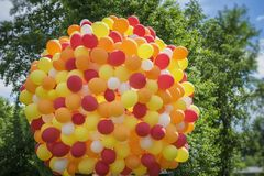 Huge bundle of balloons balloons in golden orange-red colors, party, birthday, celebration,. Festive concept. Huge bundle of balloons balloons in golden orange Royalty Free Stock Photography