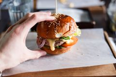 Huge burger on a wooden background close-up stock photo
