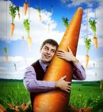 Huge carrot and man Stock Photography