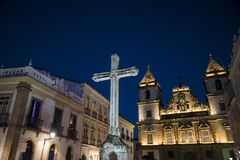 Huge Catholic Cross and church at night, Salvador, Bahia, Brazil. Huge Catholiross in front of Church of Saint Francis situated in the historical centre, one of royalty free stock images