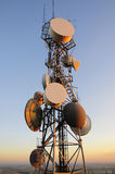 Huge cell phone satellite tower at sunset Royalty Free Stock Image