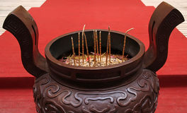 Huge censer on red carpet in a temple Royalty Free Stock Image