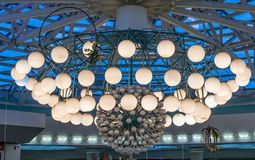 A huge chandelier in the Mall. Huge chandelier in a shopping center, city Minsk royalty free stock photo