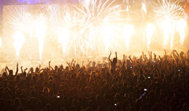 Huge cheering crowd at concert Stock Photos