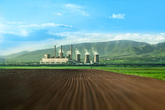 Huge chimneys of thermal power plant on a field Royalty Free Stock Photos