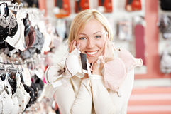 Huge choice!. The woman touches to face with hands with set of brassieres Royalty Free Stock Image