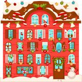 Huge Christmas house with lot of large numbered windows. Decorated with sweet cane lollipops, decorations for festive tree, plants in wreaths and dressed Royalty Free Stock Photos