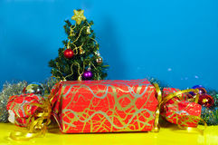 Huge christmas present and little tree Royalty Free Stock Photo