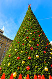 Huge christmas tree with cables and fence Royalty Free Stock Photography