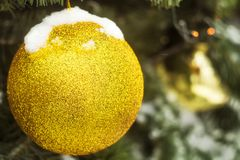 A huge Christmas tree toy. Snow amid trees Royalty Free Stock Images