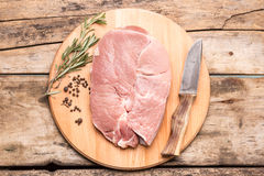 Huge chunk of meat with herbs and peppers Stock Image