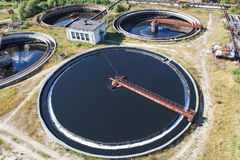 Huge circular sedimentation tanks. Huge circular sedimentation tank  Water settling, purification in the tank by biological organisms on the water station Stock Photography