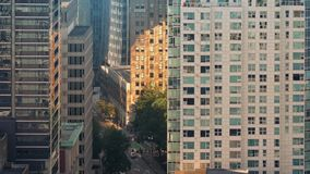 Huge City Buildings And Busy Road In Golden Sunlight stock footage