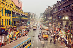 Huge city with traffic scene and colorful buildings in business district with moving buses Stock Photography