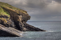 Huge cliff descend slanted into North Sea at Lybster, Scotland. Royalty Free Stock Images