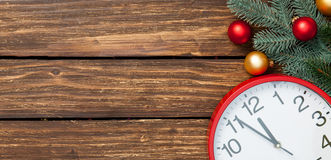 Huge clock and baubles Royalty Free Stock Photos