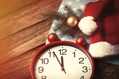 Huge clock and Santas hat with bubbles Royalty Free Stock Images