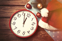 Huge clock and Santas hat with bubbles Stock Photos