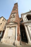 Huge clock tower of the Palladian Basilica in italian city Stock Photography