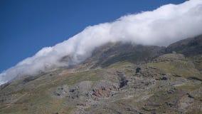 Huge cloud in Cretan mountains near Rethymno region. Greece, Crete Island stock footage