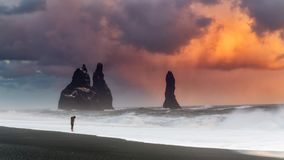 Huge clouds over black sand beach Stock Image