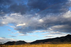 Huge clouds over mountain landscape with rainbow Tucson Arizona Royalty Free Stock Image