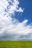 Huge cloudy skies Stock Photos