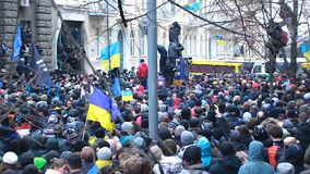 Huge cluster of Ukrainian demonstrators trying to move forward on blocked street. Stock footage stock footage