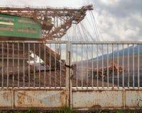 Huge coal mining coal machine behind an iron gate Royalty Free Stock Images