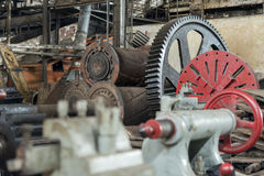 Huge cog wheel in industrial hall Stock Photo